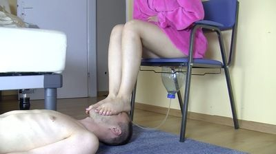 Sexy mistress uses funnel on slave