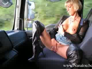 8427 - Nanalou  wearing thigh boots while travelling by truck