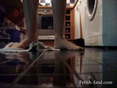 48806 - The model uses her feet to wash the kitchen floor
