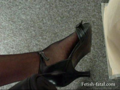 49687 - Lisa shows off her feet at work......