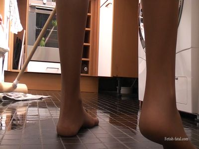 49927 - Beautiful blonde in pantyhose wets the dirty floor