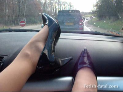 49974 - Natalia shows off her heels and feet on the dashboard of the BMW