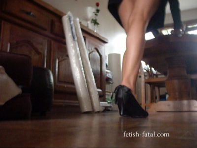 50709 - Push heavy furniture by gluing, mini skirt and high-heeled shoes .... VERY VERY SEXY......