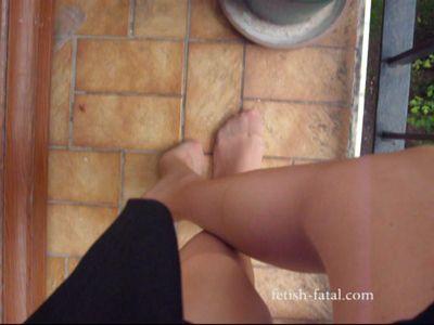 52161 - Beautiful feet in pantyhose and nude mini skirt