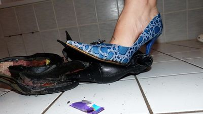 87810 - Crushing black boots with blue Pumps and spitting chocolate on it