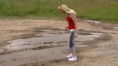 21594 - sport-socks in a mud-puddle