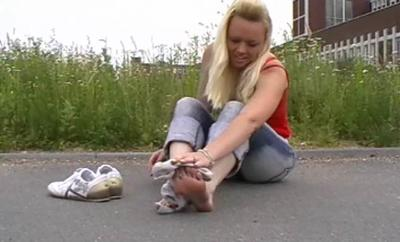 21597 - Mel puts of her shoes and socks on the street