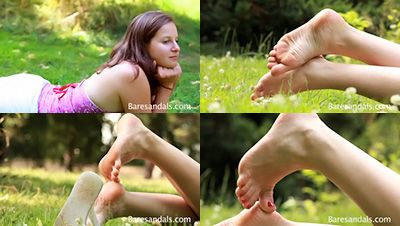 27337 - Denise flip flops and soles on the grass