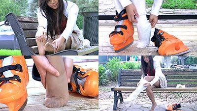 27964 - Alina nyloned feet under white socks and ice skates