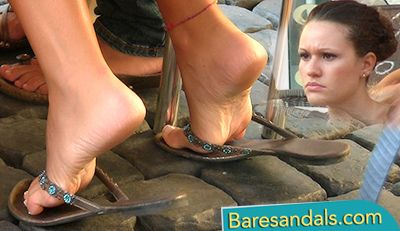 74798 - Italian girl with playful flip flops under the cafe table - 4041